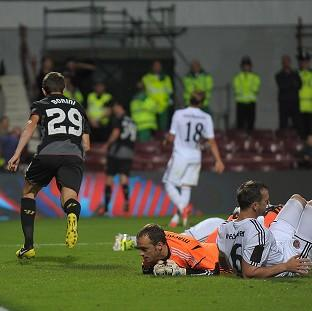 Hearts' Andy Webster, right, scored in his own net for the game's only goal