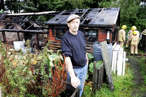 Blackburn Citizen: Michael Bibby with his burned-out shed