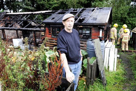 Michael Bibby with his burned-out shed