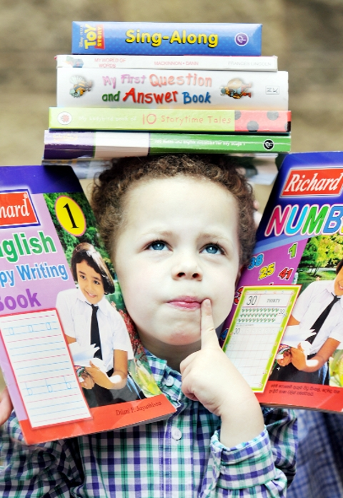 LET ME SEE... Memory master Ryan with some books PICTURE: TIM BRADLEY