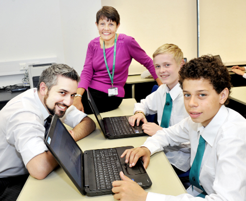 READY TO LEARN Head teacher Hilary McGonagle  and IT teacher Dom Sanna, with pupils Spencer Thomas and Tyler Branche.