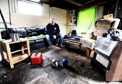 HOME COMFORTS Steve Wood in his garage, which he found full of stolen property and evidence of someone living there