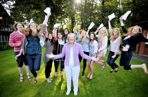 A TEAM Westholme School students celebrate last year's A-Level results with principal Lillian Croston