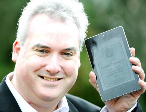 Karl Whalley with an Android tablet computer