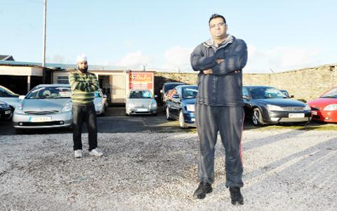 Blackburn Citizen: Sales assistant Mohammad Malik and manager Javed Imran at Daisyfield Garage, in Fort Street, Blackburn, where an Audi A3 was stolen