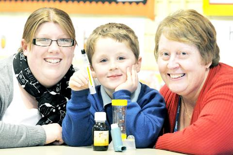 Lucas Tomlinson, centre, with mum Leanne, left, and head teacher Alison Howarth