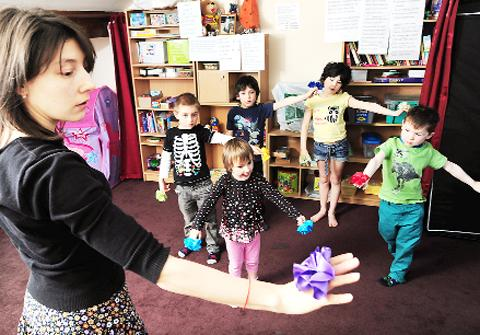 Blackburn Citizen: Playgroup leader Nastasya Smirnova with some of the youngsters in her class.