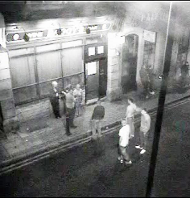 SUSPECTS: A CCTV image of the incident outside Baggy's bar, Great Harwood