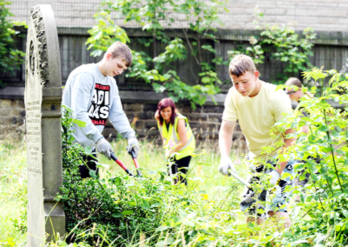 Teenagers help out last year in Darwen graveyard