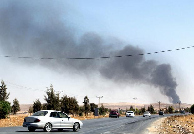 Smoke billowing from the war zone in Syria