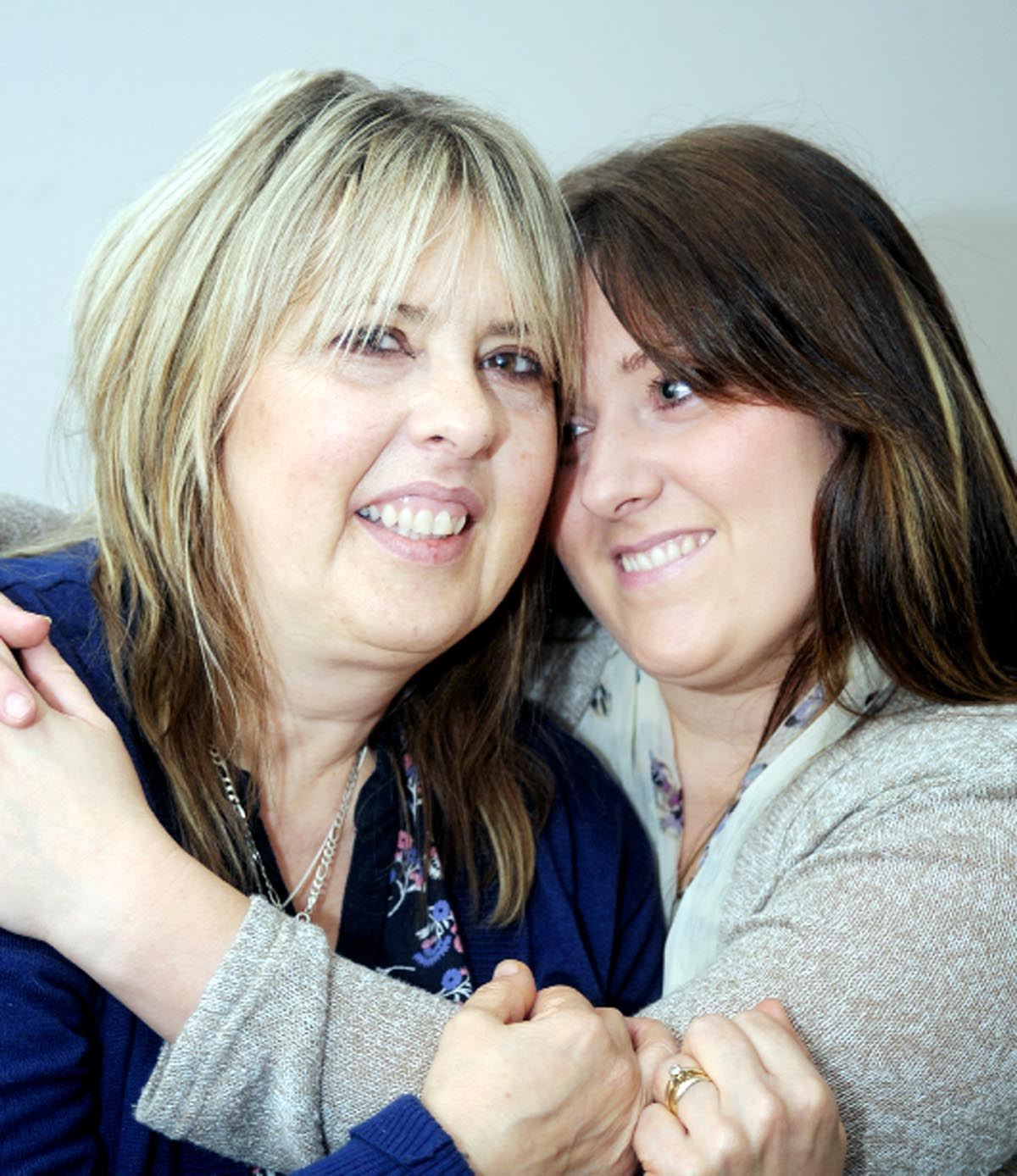 Patricia Morris, left, is comforted by her daughter Kate Hargreaves