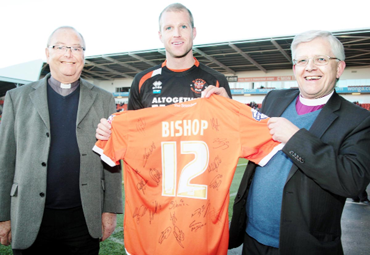 Bishop Julian, right, with Blackpool FC club chaplain the