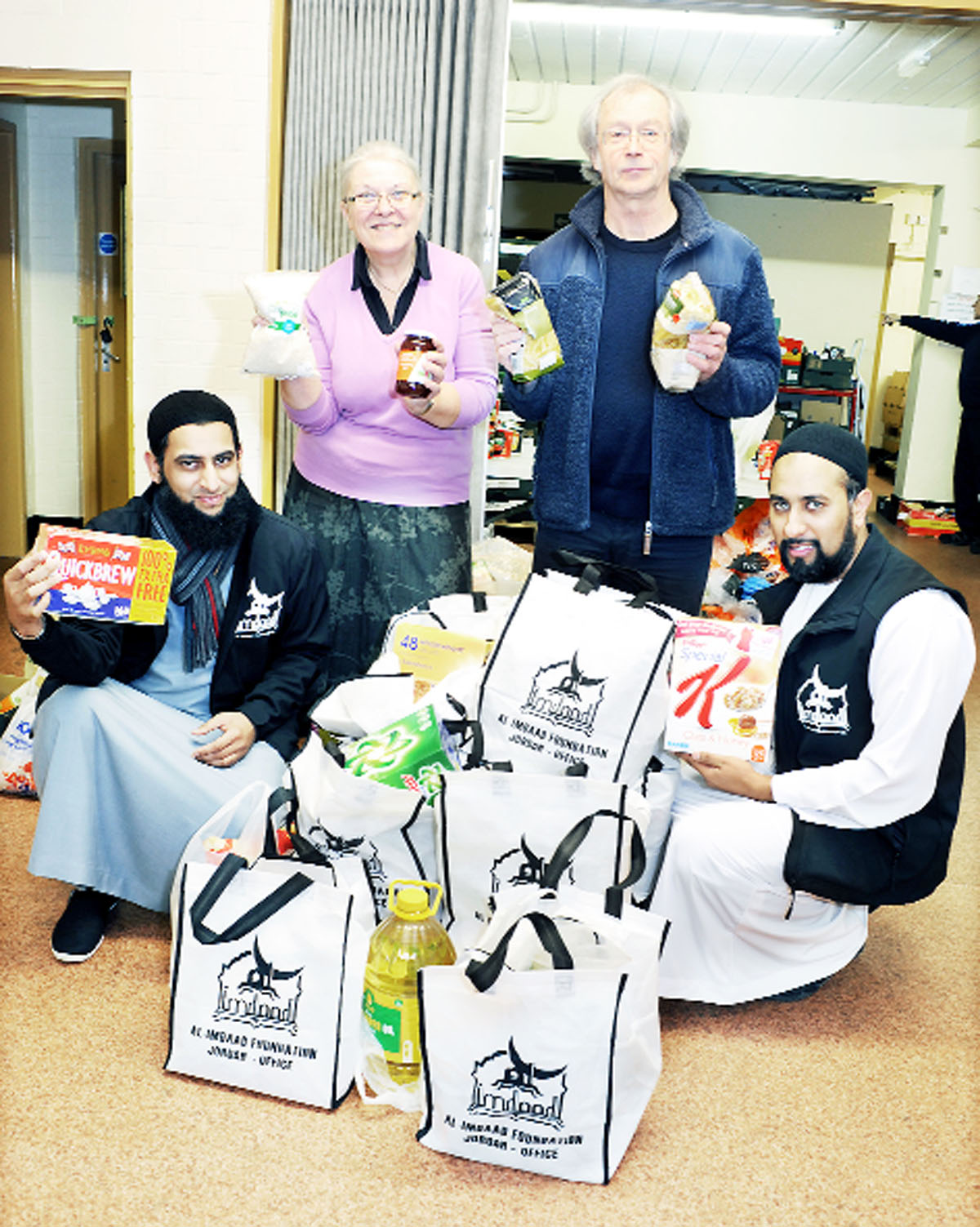 With some food from the Al-Imdaad Foundation, from left, Abdussamad Mulla (county director), Ros Duerden (Blackburn Foodbank), Coun Phil Riley and Zubair Valimulla (international projects co-ordinator)