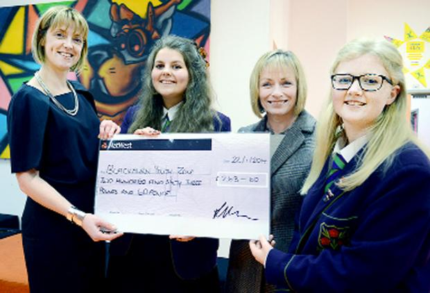 From left, the Youth Zone's Julie Wright, head girl Harriet Dagnall, principal Lynne Horne and deputy head girl Lucy Horsfield with the school's donation