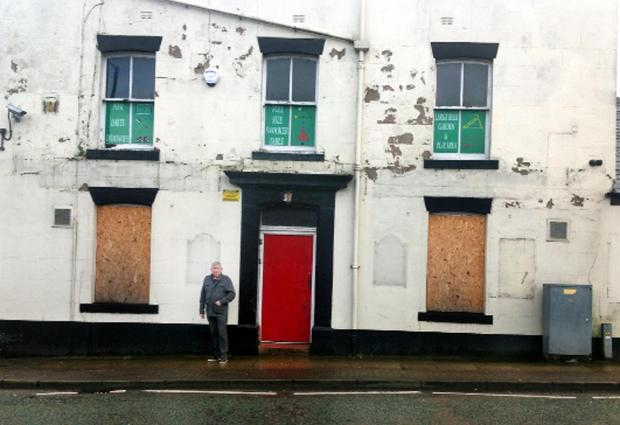 Blackburn Citizen: Coun Peter Britcliffe outside Ossy Snooker and Pool, in the former Golden Cross Inn, in Union Road
