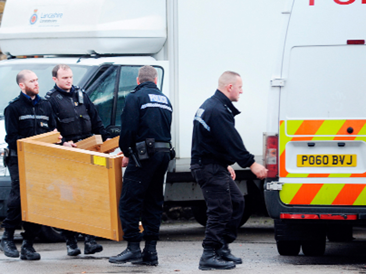 Police take away a table from the Coach House, Barrowford