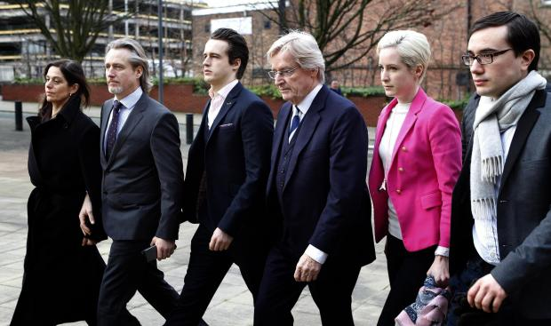 William Roache arrives at court with his family and friends