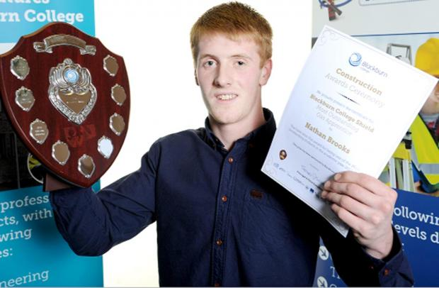 Nathan Brooks proudly shows off some of his awards