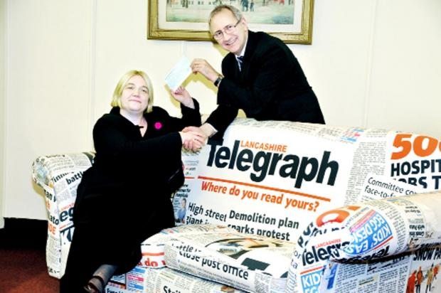 John Anson of the Lancashire Telegraph presents a cheque to Vicky Shepherd of Age UK Blackburn with Darwen