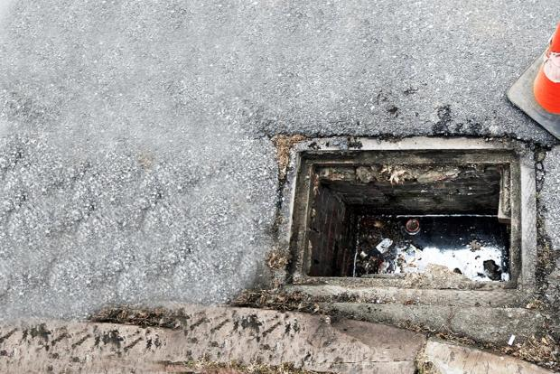 Manhole covers are one of the targets of metal thieves in E Lancs