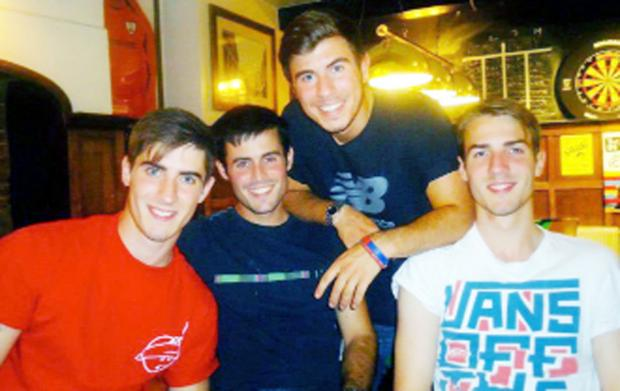 Michael Handley, right, with his brothers, from left, Sam, Tom, and Matt.