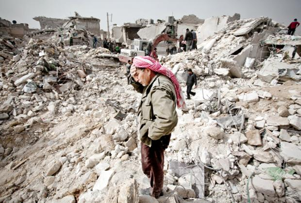 Blackburn Citizen: A Syrian man looks at the wreckage of what used to be his home
