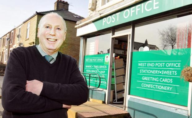 Postmaster Bill Aspin outside West End Post Office, Oswaldtwistle