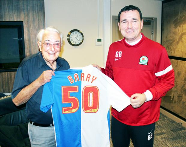 Blackburn Citizen: Barry Illsley is presented with the shirt by Rovers manager Gary Bowyer