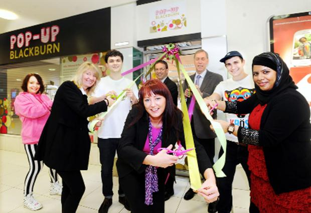 Blackburn Citizen: Launch of the Pop-Up Blackburn in The Mall. Centre, Mall market assistant Victoria Mawdsley with, from left, Amanda Logan, Sue Seddon, Sam Houghton, Mark Stevenson, Mike Damms, Jack Godden and Fatema Fulat