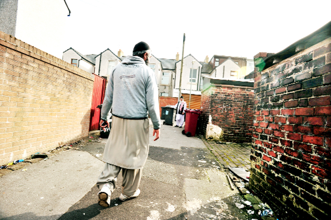 Mr Hussain in the alley where he is asking for gates