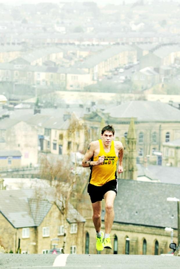 Blackburn Citizen: Andy Smith, of Almond Street, Darwen, on another training run.