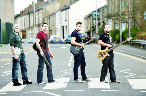 From left, Christian Slater, James McNeill, Sam Crowther and Rob Upton pay tribute to the famous Abbey Road cover