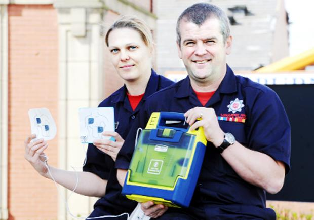 Blackburn Citizen: FFirefighters Tanya Birtwell and John Riley with a defibrillator