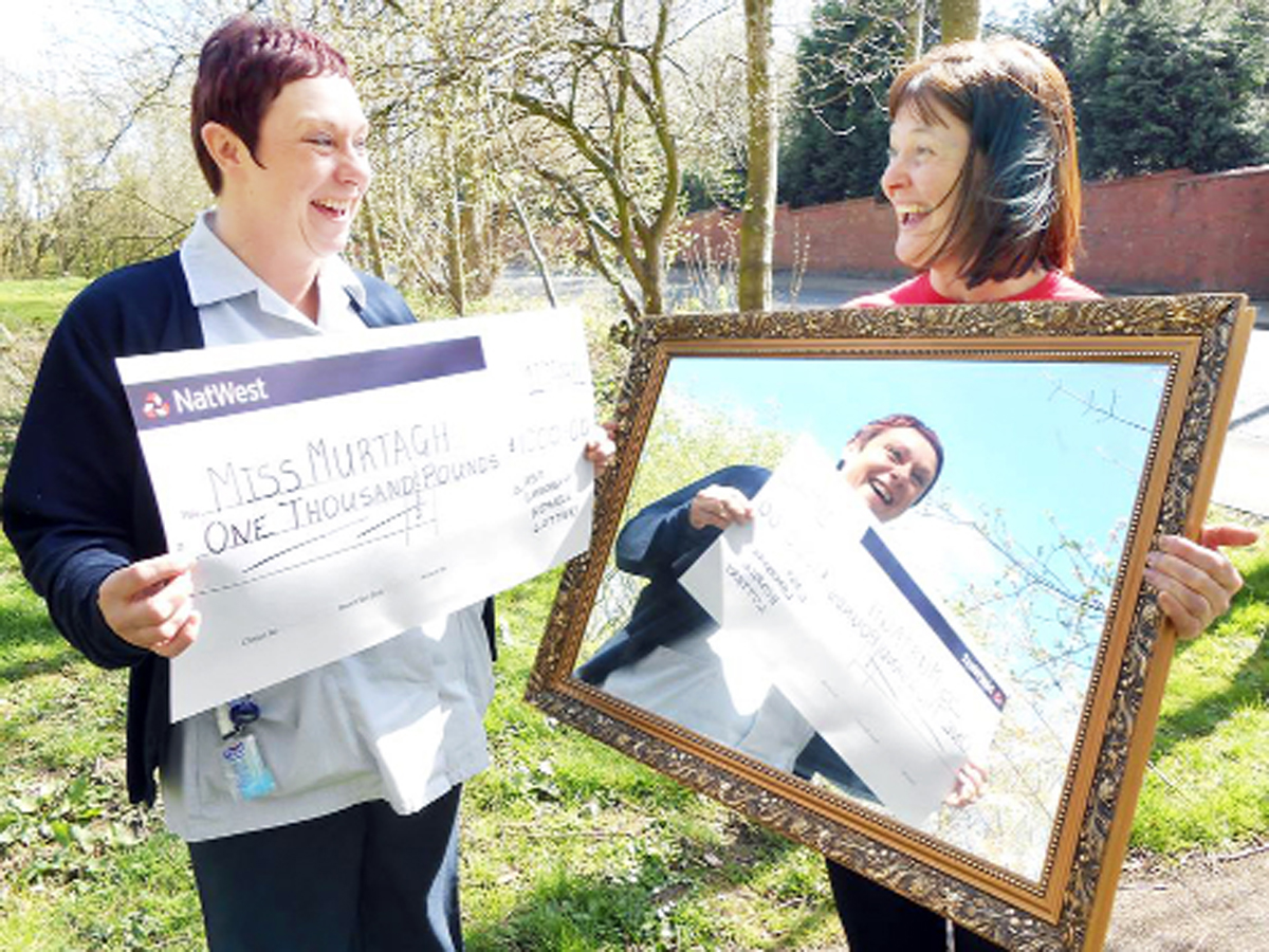 Lucy Murtagh with Gill Wilkinson from East Lancashire Hospice, has mirrored the success of her first lottery win