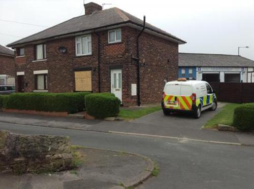 Police at the house in Harrison Road, Adlington, where a woman has been found dead.