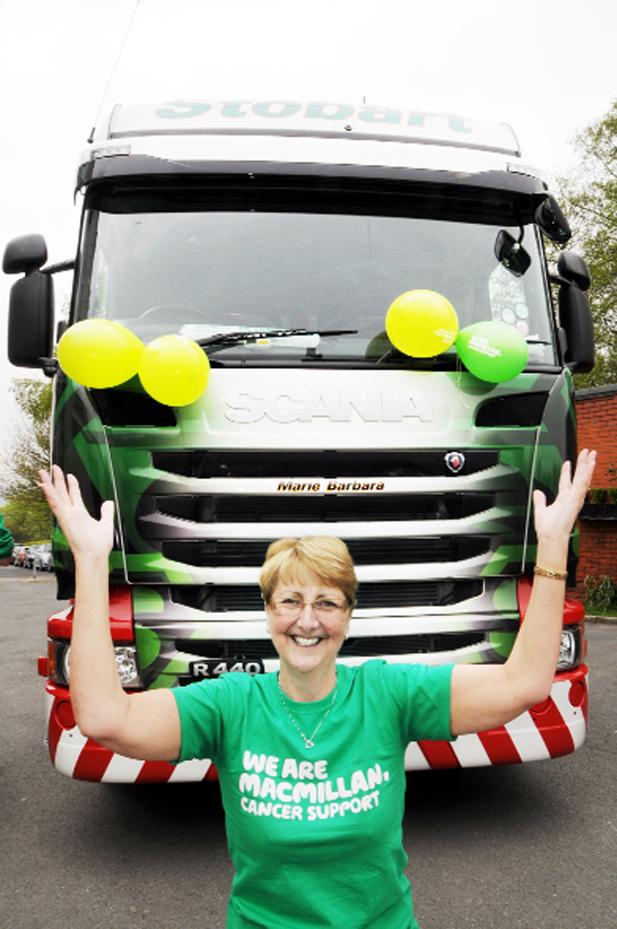 Jeanette with the truck bearing the names of Marie and Barbara