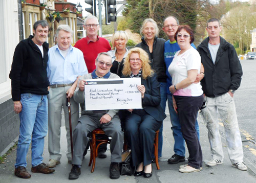Staff and customers from the Rising Sun pub with Sharon Crymble, fundraising manager at East Lancashire Hospice