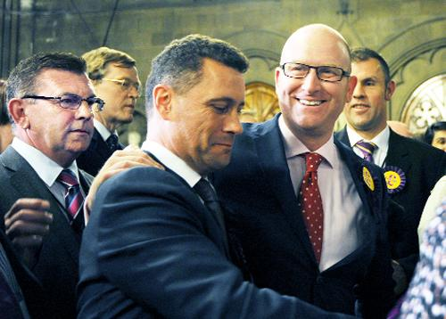 UKIP's Paul Nuttall (second right) celebrates with other party members during the Euro elections count at Manchester Town Hall.