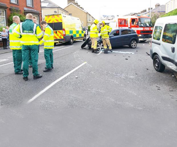 Fire crews and ambulance staff after the crash in Blackburn Road, Great Harwood