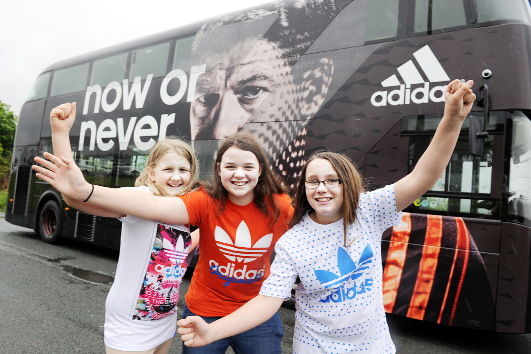 Rubie Pickup, Olivia Hilton and Lauren Blackburn with the Bus And Coach World World Cup buses