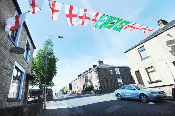Flags across Queen Victoria Road, in Burnley