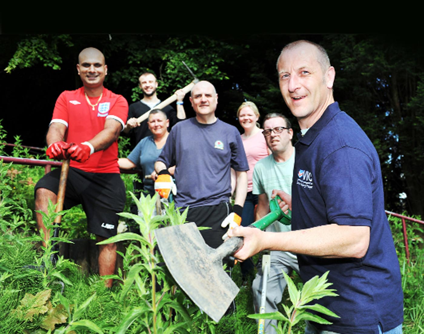 Residents of Beckett Street with members of Darwen Outreach, including war veterans, begin clearing an overgrown area