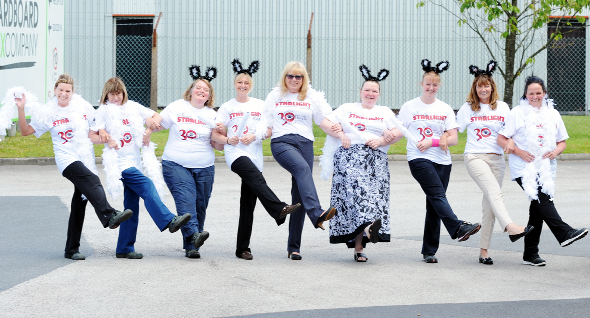 Far right, Denise Gee, centre, from the hospice, models the sparkly T-shirt for the Starlight Walk,  donated by The Cardboard Box Company, along with staff who will be taking part