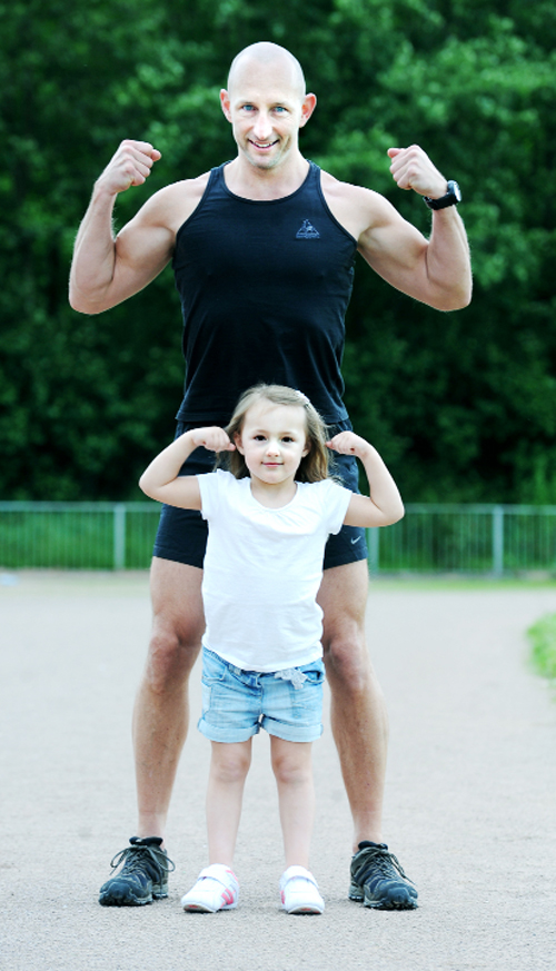 Four-year-old Natalia Edmonds is put through her training session by dad Rob