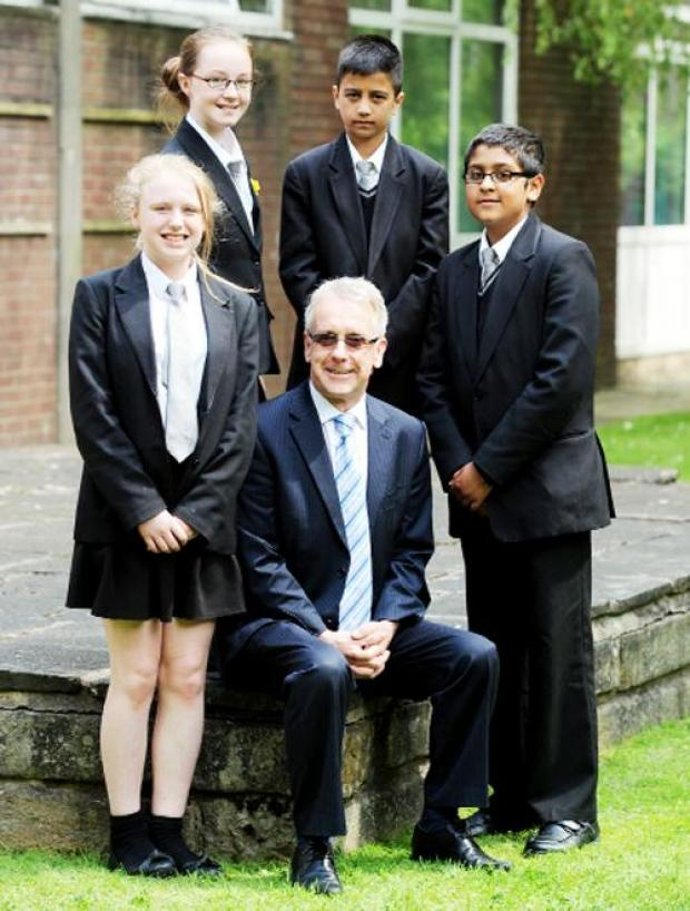Blackburn Citizen: Mr Ainsworth with pupils Alisha Brown, Athena Smith, Daniall Hussain and Shazad Khan