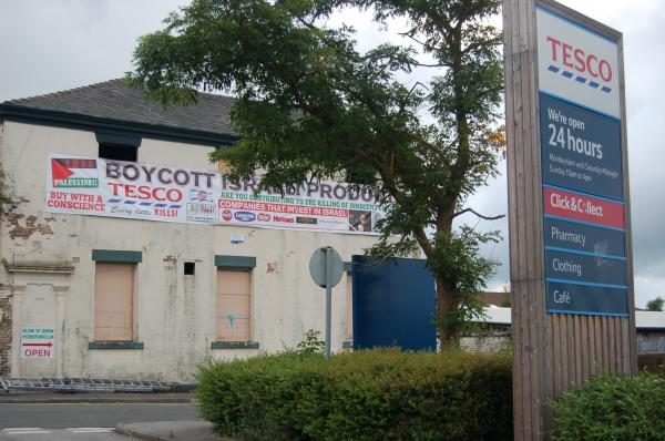 The 'boycott Tesco' banner on the derelict Duke of Edinburgh pub