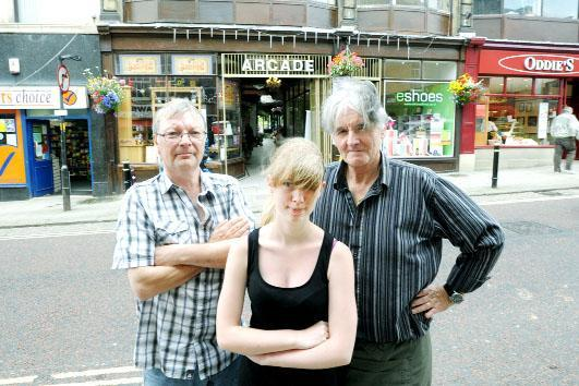 Arcade Cafe waitress Lucinda Birkett with cafe owner Frank Allinson (right) with eshoes co-owner Andrew Birkett