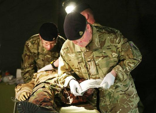 Army doctors operating in a Field Hospital are in the frontline of conflict zones.