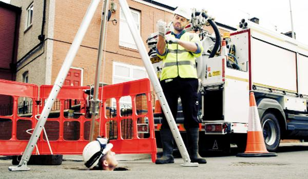 United Utilities workers Wes Odell and, right, Adrian Booth of Darwen, have been fimed for a TV commercial