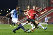 Returning United star Jonny Evans gets back to block a cross from Rovers U21s debutant Ryan Nyambe